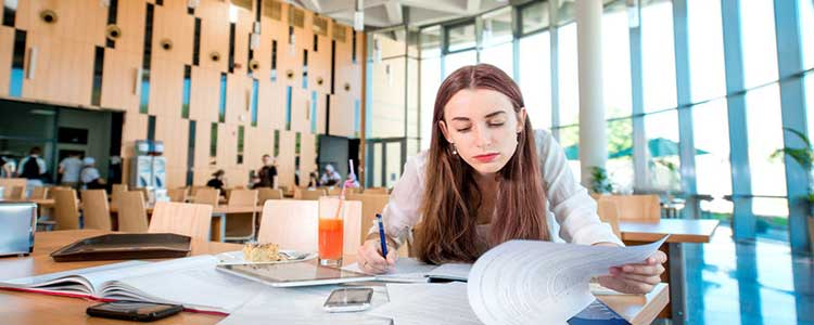 Girl Studying at a Table