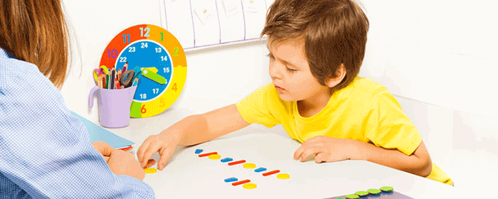 child being tested for autism within a classroom