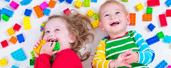 children playing with colourful lego blocks