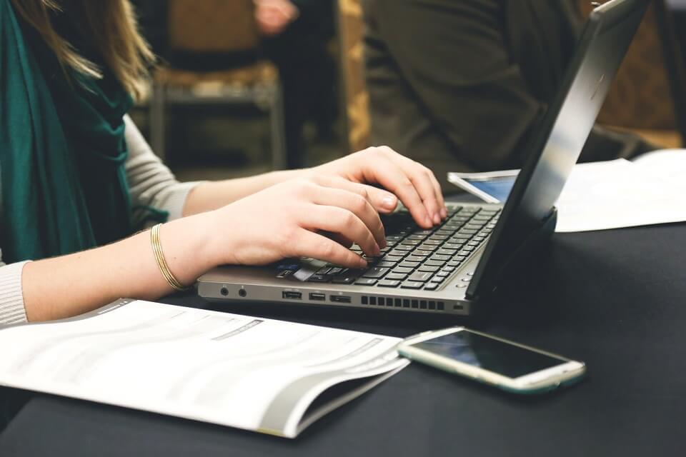 writing resignation letter on laptop